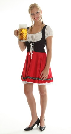 Bavarian Girl cheering in a traditional Dirndl, total view Stock Photo