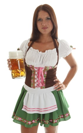 Bavarian waitress holding a Oktoberfest Beer Mug, waitress in the background photo