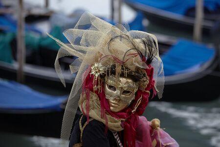 Ventian Costume in front of Gondolas
