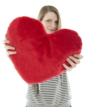 Woman holding heart pillow in the camera photo
