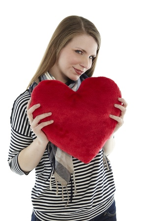 Woman holding heart pillow in her hands Stock Photo - 9332570