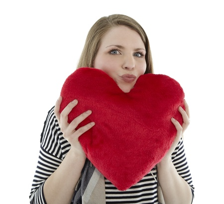 Woman holding heart pillow in her hands Stock Photo - 9332551