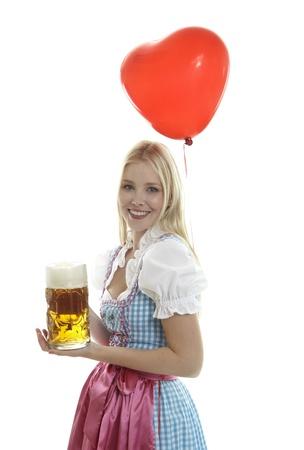 Woman in Dirndl with Balloon Standard-Bild