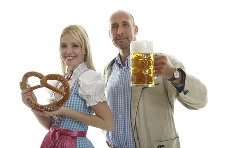 Woman in Dirndl and Man in Leather Trousers
