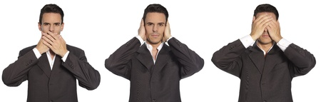 Man depicting Speak no Evil, Hear no Evil, See no Evil on White background Stock Photo