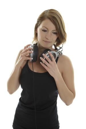 cogitate: Beautiful Woman with silver headphones Stock Photo