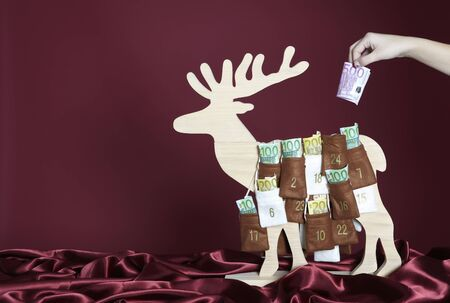 onehundred: Euro bills are taken out of an advent calendar
