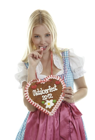 Woman bites in a German Gingerbread heart photo