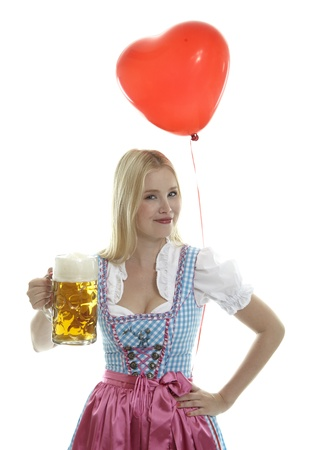 Woman in Dirndl with red heart Balloon