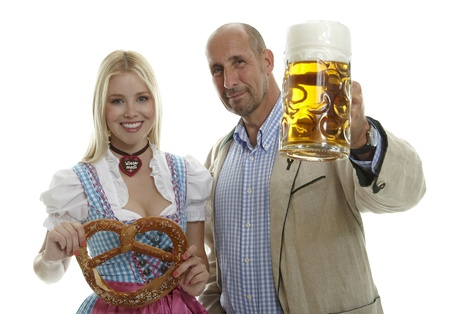 Woman in Dirndl with pretzel and Man with Beer Mug