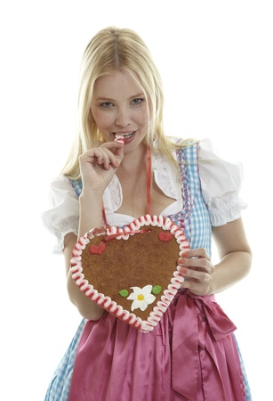 Woman bites in an empty German Gingerbread heart photo