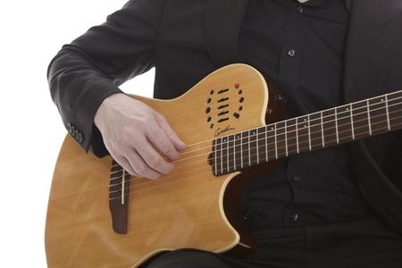 Guitarplayer on white photo