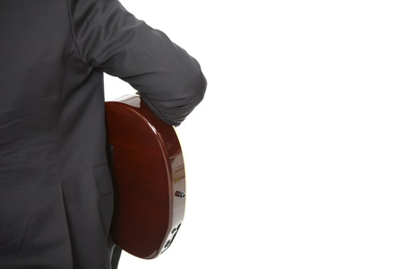 Backside of a Guitarplayer on white Stock Photo - 13442261