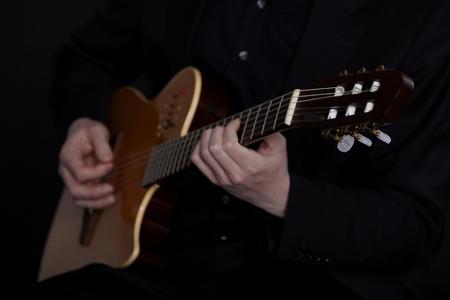 Guitarplayer on black photo