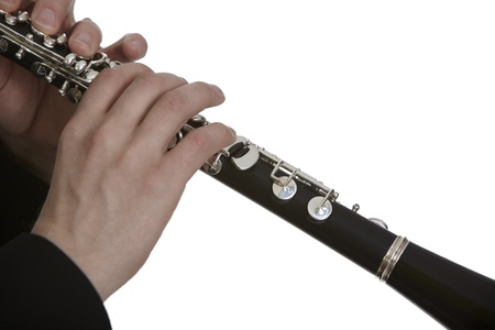 Clarinet player in front of white background photo