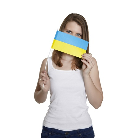 Attractive woman hides her face behind flag of Ukraine in front of white background Stock Photo - 13805983