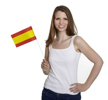 Attractive woman shows flag of spain and smiles in front of white background photo