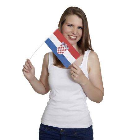 Attractive woman shows flag of Croatia and smiles in front of white background photo