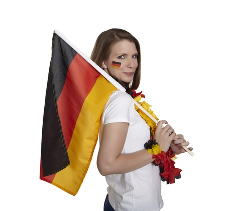 soccer wm: Attractive woman shows german flag and smiles in front of white background