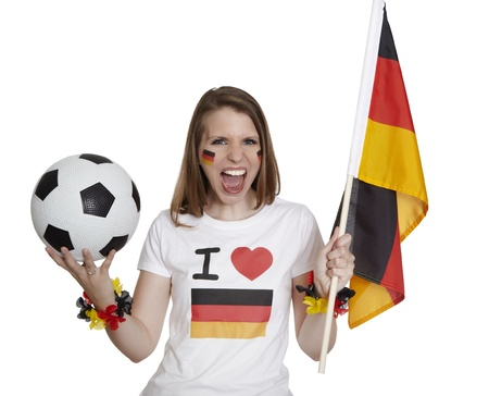 soccer wm: Attractive woman shows german flag and football and screams in front of white background