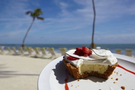 Key Lime Pie with tropical setting in the background Stock Photo