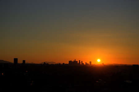 Sunrise with heat haze of Downtown Los Angeles skyline photo
