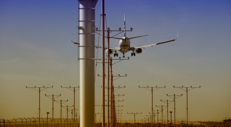 Airplane approaching for Touchdown at sunset
