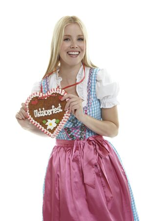 Woman with German Lebkuchen heart Standard-Bild