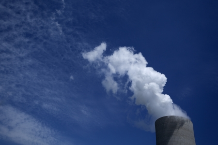 Huge cooling tower with steam from a brown coal power plant Stock Photo