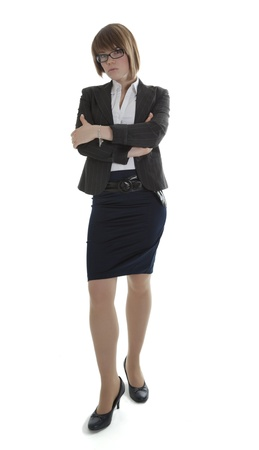 Young businesswoman standing with arms crossed on white photo
