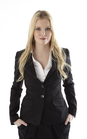 spokesperson: Portrait of a business woman with hands in pockets standing against white background