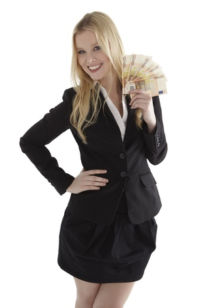 counting money: Confident young businesswoman holding currency notes and smiling