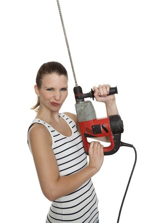 Young craftswoman with a power drill in front of white background photo