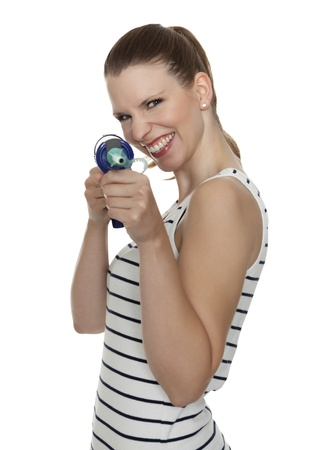 caulking: Young craftswoman with a caulking gun in front of white background