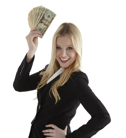Confident young businesswoman holding currency notes and smiling photo