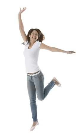 Beautiful young woman jumps for joy photo