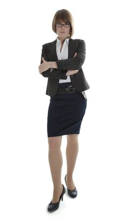 demanding: Young businesswoman standing with arms crossed on white