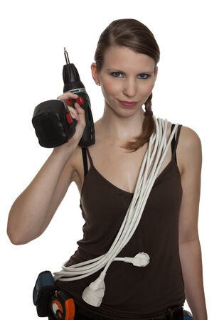 power drill: Young craftswoman with a power drill in front of white background Stock Photo