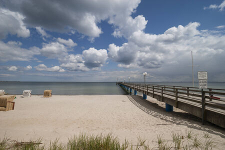 Wooden pier over the Baltic Sea with clouds photo