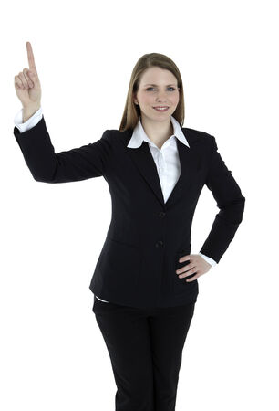 Business woman points at something on the top of the image. Isolated on white background. photo
