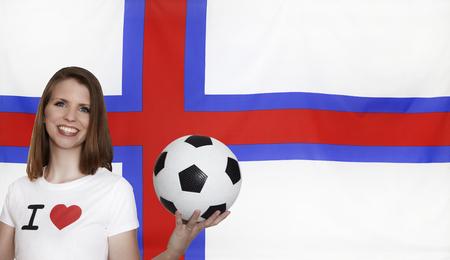 female soccer: Faroe Islands Flag with female soccer fan Stock Photo