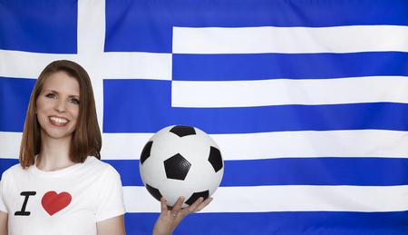 female soccer: Greece Flag with female soccer fan Stock Photo