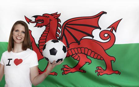 female soccer: Wales Flag with female soccer fan