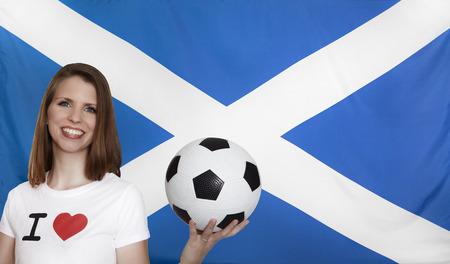 female soccer: Scotland Flag with female soccer fan