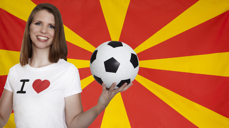 magazine stack: Macedonia Flag with female soccer fan