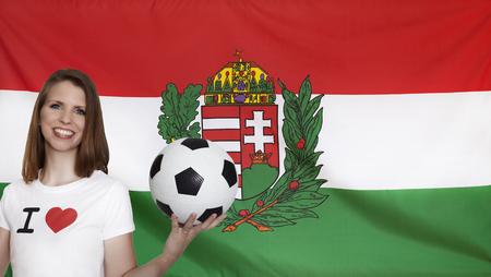 female soccer: Hungary Flag with female soccer fan Stock Photo