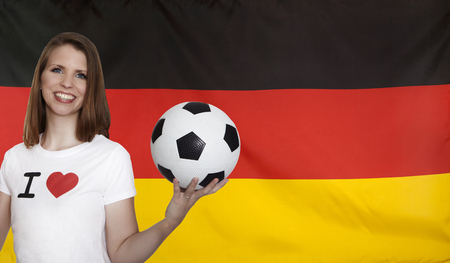 female soccer: Germany Flag with female soccer fan Stock Photo