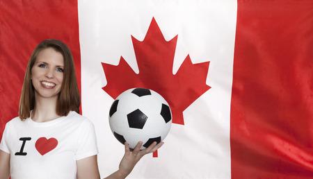 female soccer: Canada Flag with female soccer fan Stock Photo