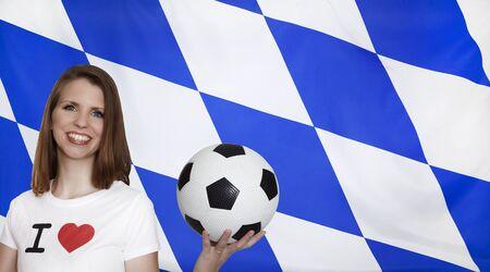 female soccer: Bavaria Flag with female soccer fan