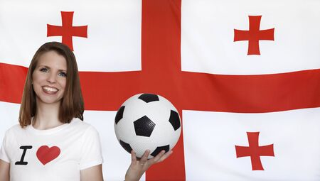 female soccer: Georgia Flag with female soccer fan Stock Photo